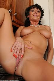 Mature Brunette MILF Amber Jane with Big Naturals Wearing Black.