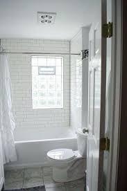 premade glass block windows white subway tile gray grout glass block window