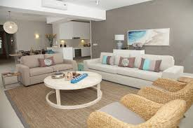 accessories living room interior design with bali furniture style four seater comfy sofa two seater sofa two rattan armchair and round coffee table