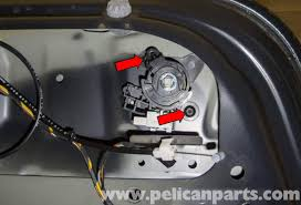 bmw e60 5 series trunk lock cylinder and latch replacement 2003 lock cylinder remove the two t25 torx trunk lock cylinder fasteners red arrows