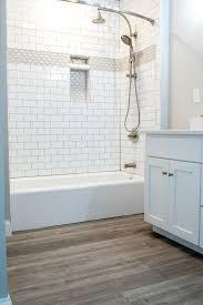 vinyl plank bathroom white tiled shower with accent strip and niche oak luxury vinyl plank bathroom vinyl plank bathroom
