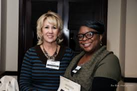 Brenda Tighe of the Frisco Heritage Center is welcomed by Lisa ...