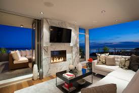 see through indoor outdoor gas fireplace modern living room vancouver by montigo fireplaces