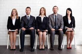 how to prepare for an interview for mba admission part i a picture that shows three women and two men in suits seated in the correct