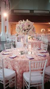 Blush satin rosette tablecloths Pink wedding reception decor with white  chairs Pink centerpieces