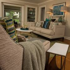 beautiful contemporary livingroom contemporary living room with leather chair sea glass color scheme and glass lamps with grasscloth backed bookcase paired