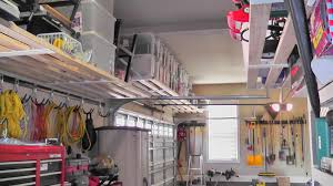 small and narrow garage organization ideas using custom diy wood wall mounted overhead storage shelves and hook tools ideas