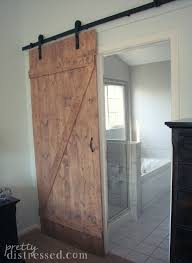 Overlapping Sliding Barn Doors Bathroom Barn Door Reused Old Barn Door Creates A Fabulous