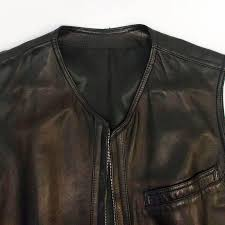 gianni versace limited edition black leather vest with silver safety pins engraved at the bottom with