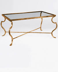 rectangular wrought iron coffee table with distressed antiqued gold leaf finish and glass top