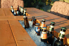 patio table with built in beer wine coolers with beer