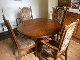 dark oak round dining table in excellent condition