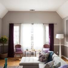 gray and purple living room with chair rail