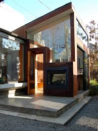 luxury outdoor fireplaces in modern entry with concrete
