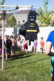 lego batman piñata activity during birthday party