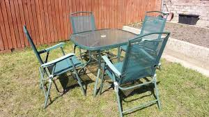 green metal garden furniture set round glass table with umbrella hole x4 folding chairs arm