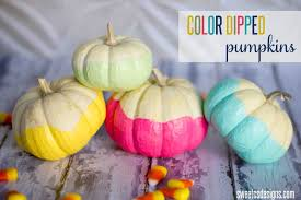color dipped pumpkins via sweet c s designs for a non traditional look dip mini pumpkins in vibrant paint colors to make them stand out in a row