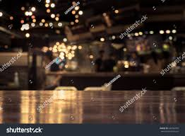 restaurant table top lighting. Wood Table Top With Reflect On Blur Of Lighting In Night Cafe,restaurant Background/ Restaurant