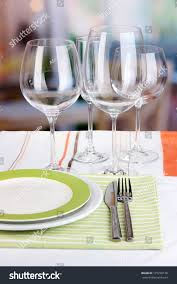 glasses table setting. Table Setting With Glasses For Different Drinks On Room Background
