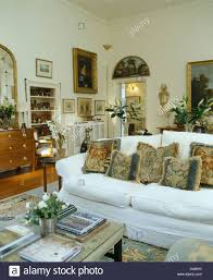 Tapestry Sofa Living Room Furniture Tapestry Cushions On Sofa With White Loose Cover In White Country