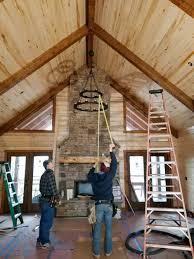 chandelier in vaulted living room