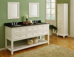 white bathroom vanity with black marble top