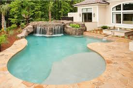 pebble finishes have a more rustic look and complement natural surroundings they are often used for tropical or lagoon style pool designs
