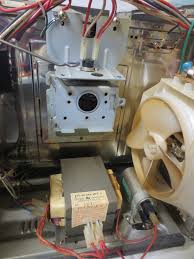 microwave blow up and other electrical repairs pete s qbasic site watch out for the high voltage transformer and capacitor below the cap can hold 5 000 volts unplugged