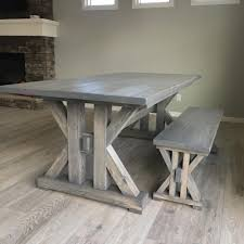 a farmhouse table and a bench in a dining room