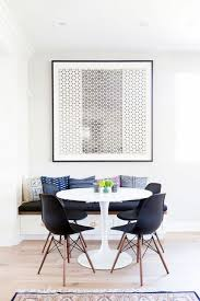 Ikea dining room chairs Round Minimal Dining Nook With Large Art An Ikea Round Table And Black Chairs Pinterest Times Ikea Looked Deceptively Elegant Home Inspiration