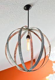 wine barrel rings were used to make a chandelier hang on vaulted ceiling filament bulb was added continue the antique feel restoration hardware
