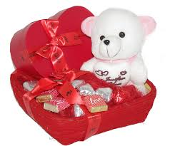 darling her with a heart box of chocolates teddy bear and other orted chocolates