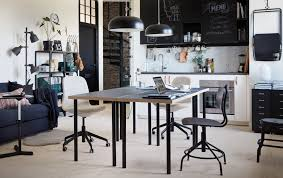 office kitchen tables. a black and white kitchen with two tables backtoback in the centre office