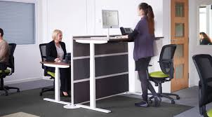 why sit stand desks create a healthier work environment the there