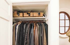 baskets and wooden hangers go a long way to keep this coat closet in order