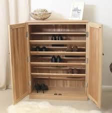 image of the baumhaus mobel oak large shoe cupboard cor20d with doors open showing baumhaus mobel oak 1