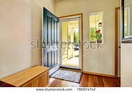 open front door. Small Foyer With Green Open Front Door, Laminate Floor And Wooden Bench. Northwest, Door