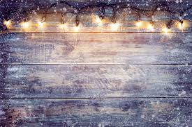 Wood With Lights Christmas Lights Bulb With Snow On Wood Table Merry Christmas