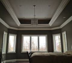 Trey ceiling with a three layer crown design and orange peel textured  ceiling.
