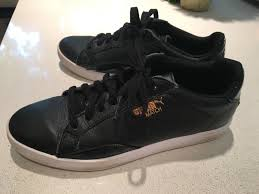 puma black leather tennis shoes with gold logo 6 5 women s puma shoes puma running shoes luxury lifestyle brand