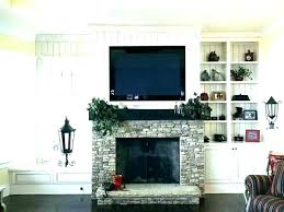 how to hide wires over brick fireplace mount on behind tv wall lcd fi