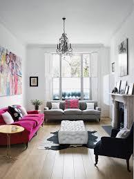 pink sofa and matching artwork