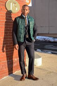 How To Wear A Puffer Vest: 4 Ways To Style A Down Vest   Men's Fashion & Barbour$129 · Pairing a dark green gilet and a black striped suit will  create a powerful and confident Adamdwight.com