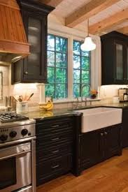 black cabinets farm sink wood sink industrial stove i love the look of the black but after having a black stove top i will never do black in a kitchen