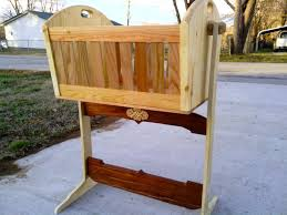 custom made wooden rocking cradle in cherry oak and pine