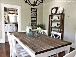 two tone barn wooden dining room farm tables with white and brown finished and white armless dining chair set
