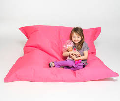 girl playing in pink beanbag chair