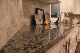 Ice White Shaker Forevermark RTA cabinets with Caledonia granite and marble  back splash