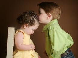 cute forehead kiss of baby