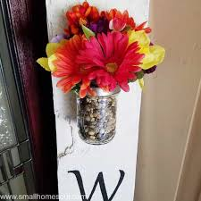 colorful bouquet at top of diy welcome sign